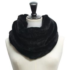 The finest, softest, and most plush faux fur was used to create this luxurious neck warmer scarf. The entire scarf, inside and out, is made from this fine warm cloche fur. Each end is sewn together to create a stylish circular ring shape, and one end is sewn in a twist to create a gathered and bunched look. 100% Polyester Great for Gift Giving Scarf measures 14 inches wide. Scarf measures 18 inches long, end to end.