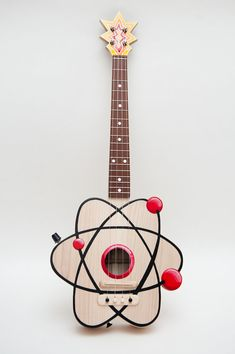 The Atom Ukulele by Celentano Woodworks on Etsy. (Also available, Rock 'Em Sock 'Em Robots Ukelele, Pacman Ukelele, Avocado Ukelele, Snail Ukelele.....)