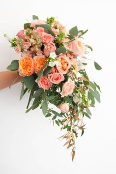 garden rose vuvuzela in a cascading waterfall bridal bouquet with gold ruscus eucalyptus and spray roses, by floral magic