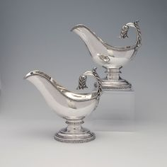 A Pair of Early American Silver Sauce Boats, Thomas Fletcher, Philadelphia, PA,  c.1830, 7 3/4''(H) 54 oz. 10 dwt. - Each of oval form on conforming stepped pedestal foot, the flying scroll handle with leaf cap & bold foliate terminal, with molded leaf bands throughout.  Thomas Fletcher (1787–1866), working on his own & in partnership with Sidney Gardner, was one of the most important American silversmiths of the first half of the 19th century.