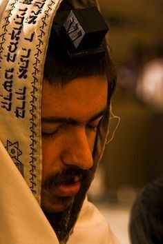 A Man in Israel wearing his Tallit Prayer Shawl.