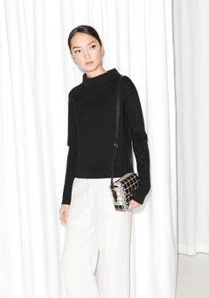 Knitted wool blended with cotton makes up this chic sweater with an alluring turtle neck.
