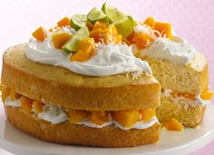 Mango Layer Cake  Sweet-tart mangoes impart a terrific tropical taste to a cake that relies on a mix and creamy canned frosting.