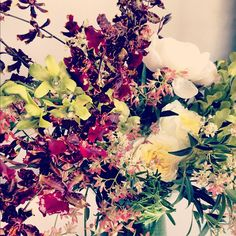 Brown oncidiums from Japan, Thai green dendrobiums, garden roses & peonies.