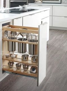 The perfect kitchen addition for dads who love to grill: Diamond's Base Utensil Pantry Pullout Cabinet. This clever design fits into slim spaces and features large stainless steel canisters for storing grilling tools and supplies.