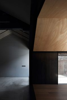 """Ming Gu Design described its intentions as """"superimposing"""" modern architecture onto the courtyard. The glazed room allows for light to move across the house throughout the day, casting linear patterns across the central space, in contrast to the darker spaces of the older building."""