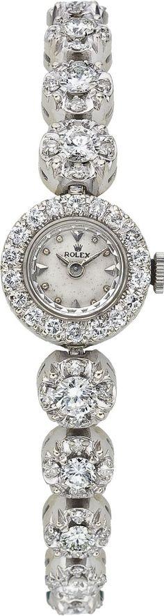 Rolex Lady's Diamond, White Gold Integral Bracelet Wristwatch, circa 1950
