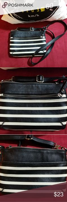 NWOT Black & White striped Merona Purse This purse has never been used. I loved it, but it couldn't fit my giant wallet+my life so it has sat quietly in the closet. NWOT Black & White striped Merona Purse. There are lots of pockets, and the length is adjustable! It's a day to day must have. Merona Bags Crossbody Bags