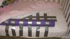 use pool noodles taped to the mattress with duct tape for toddler bed transitions