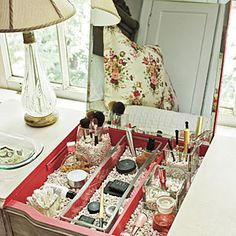 Clear glass vases double as makeup and brush holders, while a layer of gravel helps keep the cosmetics secure.