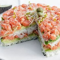 If sushi burritos aren't your thing, sushi cake might be more your speed. Or just have sushi parties where you eat both of these wonderful creations together. Sushi Torte, Sushi Cake, Seafood Recipes, Cooking Recipes, Asian Recipes, Healthy Recipes, Salmon Sushi, Salmon Avocado, Raw Salmon
