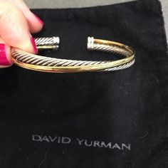 David Yurman crossover bangle Perfect condition, no flaws, dents etc...hardly worn! Comes with cloth. 100% authentic David Yurman Jewelry Bracelets
