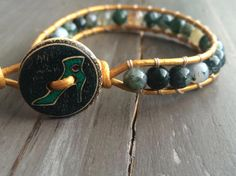 Green earth tone mixed jasper beads on leather cording with high heel button clasp