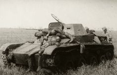 """gruene-teufel: """"Dead Soviet crew lay on their knocked-out T-60 light tank while German troops inspect the vehicle """""""
