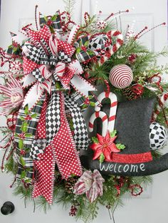 "The first wreath design of the Christmas 2016 collection. A huge statement designer series wreath welcoming the season with so many wonderful elements. ONLY ONE AVAILABLE - Built on a 30"" Appalachian"