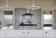 kitchen with marble - like how they have separate frig/freezer