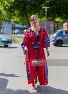 Jana Polliani  wearing red dress and Gucci bag outside Ganni during the second day of the Copenhagen Fashion Week Spring/Summer 2017 on August 11, 2016 in Copenhagen, Denmark. (Photo by Christian Vierig/Getty Images)