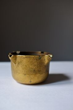 Vintage ashtray in solid brass. Originally some sort of mortar by pharmacists