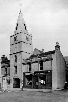 Newton Tower, Main Street, Ayr This steeple was built in 1792-5 as the central feature of a town-house, most of which, along with the adjacent parish church to the E, was demolished in 1967 for road-widening. The church had been built in 1777 and the steeple rises over a pend which formed the main entrance to the churchyard. It now stands on a traffic-island. The steeple comprises a five-stage tower, 5m square at ground level, which carries an octagonal stone spire, and it is 21.7m in… Ayr Scotland, Main Entrance, Town Hall, How To Level Ground, Main Street, Touring, Townhouse, Maine, Paisley Scotland
