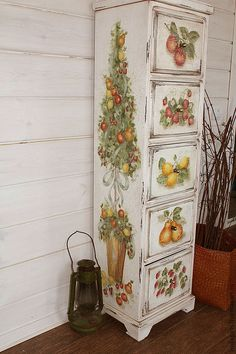 Beautifully painted with vintage looking fruit designs this old dresser would look great as a part of a country kitchen or a dining room.