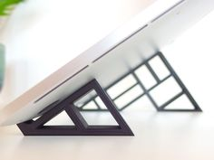 """The geometric stand"" for MacBook Pro Retina will raise your laptop and your…"