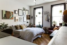 A 280 Square Foot Studio Charmer in Crown HeightsEmily's favorite element in her Crown Heights apartment is the collection of her grandfather's paintings. But really, there's lots to love in her charming 280 square foot apartment: the art, the ample seating, and the beautiful brick wall.