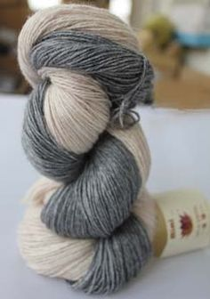 I bought a skein of this mink yarn at Raging Wool in Weston.  My skein is completely grey.  Cannot wait to use it.  Wondering if I should see if they have a girlier color and knit something for my niece Mimi ....