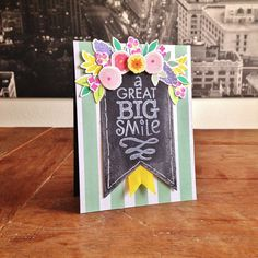 "Great Big Smile Card. Cardstock: Folia, SU; DP: AC (""Dear Lizzy/Lucky Charm""); stamps: Hero Arts (""A Great Big""), Basic Grey (""Highline""); Wplus9 (""Fresh Cut Florals""); ink: SU, Versacolor; ribbon from my stash."