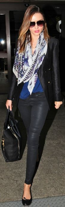 Who made Miranda Kerr's print scarf, black skinny jeans, sunglasses, and black handbag that she wore at LAX airport on April 22, 2012? Scarf – Balmain  Sunglasses – Dita  Jeans – Hudson Nico  Purse – Celine