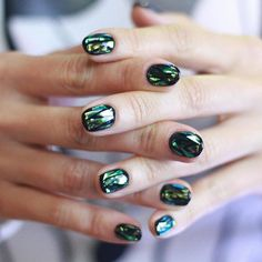 Shattered glass nail art, created by Korean artist @nails_unistella