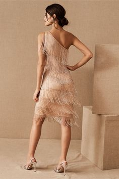 Decked out in tiers of beaded fringe, this one-shoulder party dress gives major flapper vibes. Holiday Party Dresses, Holiday Parties, Bhldn, Adrianna Papell, Anthropologie, One Shoulder, Stylists, Gowns, Formal Dresses