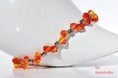 Swarovski bicone bracelet - delikatna, urocza bransoletka z kryształów SWAROVSKIEGO - BICONE FIREOPAL i japońskich koralików MIYUKI, ze srebrną ( 925 ) zawieszką w kształcie rybki, zapięcie posrebrzane. Przepięknie lśni w...