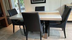 TABLE KÉNOGAMI - BÉTON CIMENT - FRÊNE BLONDE - 60'' X 40'' X 2.25'' ÉPAIS - CHAISES SINATRA CUIR VEGAN NOIR - BUFFET AUGUSTA #lusine #table #kenogami #beton #ciment #frene #blonde #chaise #sinatra #cu0095 #buffet #augusta Buffet, Dining Table, Tables, Furniture, Home Decor, Cement, Chairs, Leather, Mesas