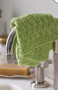 Add some elegance to your bathroom with this crocheted washcloth. The shell pattern is quick to learn, and the cotton yarn feels wonderful: FREE crochet pattern