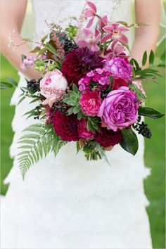 Stunning Wedding Bouquet Which Includes: Sangria Dahlias, Hot Pink Garden Roses, Pink Cymbidium Orchids, Pink English Garden Roses, Hot Pink Dianthus, Pink Astilbe, Dark Blue Privet Berries, Red Ranunculus, Green Succulent + Several Varieties Of Greenery/Foliage