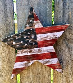 Primitive Wood Star with Rustic American Flag Paper. ⭐️ Wooden star is stained a rich dark walnut with a rustic American flag paper overlay, antiqued and sealed. ⭐️ Primitive Wood star is ready to hang or prop. Americana Crafts, Patriotic Crafts, July Crafts, Primitive Wood Crafts, Primitive Stars, Wooden Crafts, Fourth Of July Decor, 4th Of July Decorations, July 4th