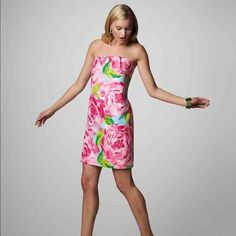 Lilly Pulitzer First Impressions dress Lilly Pulitzer Hotty Pink First Impressions dress size 12 only worn once. I haven't decided if I want to sell this dress just trying to see if anyone is interested. Open to offers! Lilly Pulitzer Dresses Strapless
