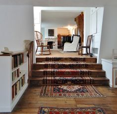 BrandonRugs.com) The installation of the hand-knotted stairway runner is not optimal. But keep in mind that such rugs exist to gracefully cover such stairwells. (Upstairs: Kettles yard , Cambridgeshire England)