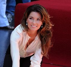 Shania Twain was born Eileen Regina Edwards in Windsor, Ontario, Canada, on August 28, 1965. Twain recorded her first album in 1993. Her next album, The Woman in Me, sold millions of copies and established Twain as a crossover star. Come on Over, released in 1997, sold more than 40 million records to become the bestselling album by a female artist, and the bestselling country music record ever.