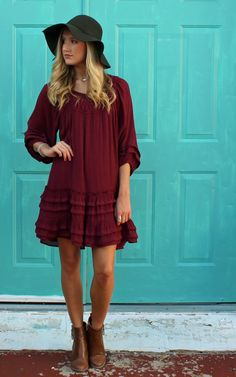 Dreamland Dress by Entro clothing, boho fashion, bohemian style, free people, anthropologie. Fully lined pullover dress. Crochet at front neckline. Lots of fullness to this comfy dress. 3/4 sleeves with tucking. Hemline also features tucking and self ruffles. Polyester, Rayon