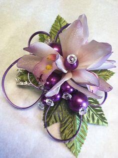 Delicate purple-tipped orchids for prom... By Merritt's Flowers, Pitman, NJ www.merrittshouseofflowers.com