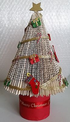 Folded book art Traditional style Christmas Tree with base ideal for a table centre piece or gift. A handcrafted folded book Christmas Tree is made from a recycled second hand book from a smoke & pet free environment. Christmas Projects, Holiday Crafts, Book Christmas Tree, Book Page Crafts, Altered Book Art, Magazine Crafts, Book Folding Patterns, Folded Book Art, Diy Weihnachten
