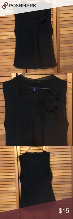 Tank top. Classy black tank with ruffled detail on right collar bone with ribbons falling on either side. Great for work paired with your favorite pants or super cute with jeans & heels for a day or evening outing. Very versatile. In excellent condition, no pulls or stains. GAP Tops Tank Tops