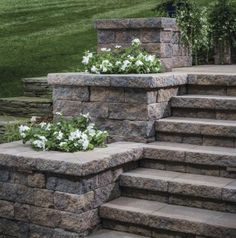 Stair or step planters can take a variety of shapes and styles. Options can include symmetrical tiers, terraced landings, or a singular accent planter. Retaining Wall Steps, Backyard Retaining Walls, Concrete Retaining Walls, Sloped Backyard, Backyard Patio, Concrete Steps, Patio Stairs, Front Stairs, Brick Planter