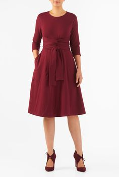 A knot front with ties below layer our empire waist cotton knit dress, finished with a full skirt for a feminine fit-and-flare silhouette.