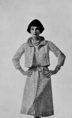 Bronwen Pugh (Lady Astor) in white and gold brocade suit, small short jacket lined in pale rose shantung , by Chanel, photo by Georges Saad, 1957