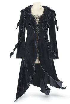 Jackets Pagan Wicca Witch:  Enchantress Hooded Maxi Jacket. Concealed in velvet---mystery and romance live in the details of this maxi-length sensation, with its attached hood, tendrilled collar, and inviting, cross-laced bodice. Note the lush, lettuce hem and long, slightly flaring sleeves.