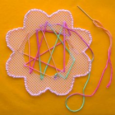 A sewing flower- simple and fun activity that teaches kids basic sewing (great for fine motor)