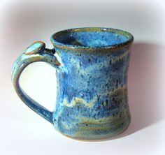 Blue Pottery Coffee Mug, Ceramic Coffee Cup, Turquoise Blue Glaze, Thumb Rest. $18.00, via Etsy.