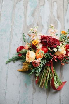 Totally lovely autumn colored fall wedding bouquet | http://www.weddingpartyapp.com/blog/2014/09/18/fresh-fall-wedding-bouquets-romantic-bride/